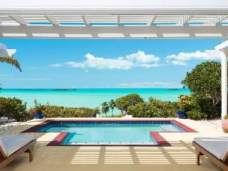 Luxury beachfront villa surrounded by sparkling turquoise water on the beautiful island of Providenciales in Turks & Caicos - Leeward vacation rentals