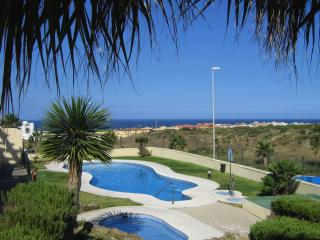 Stylish 2 bedroom apartment with seasonal pool, private parking, storage & wifi - Tarifa vacation rentals