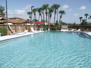 Large shimmering pool, tennis courts & playground - Palm Bay vacation rentals