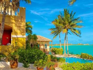 Beachfront Three Cays Villa, gated with lush gardens, natural sea reefs & pool - Turks and Caicos vacation rentals