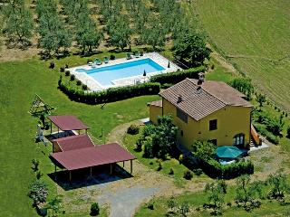 In the heart of the rolling Tuscany hills, staffed farmhouse features shared swimming pool, playground, private garden and terrace - Villamagna vacation rentals