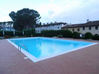Cozy Condo with Shared Outdoor Pool and Television - Leccio vacation rentals