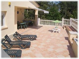 Marblau, fenced pool in front of villa. Playground - Canyelles vacation rentals