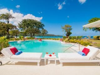 *PLEASE ENQUIRE FOR SPECIAL RATES* Luxury 5 Bed Fully Staffed Beachfront Villa - Discovery Bay vacation rentals