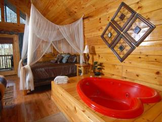 Naughty by Nature a romantic one bedroom cabin with heart shaped Jacuzzi. - Pigeon Forge vacation rentals