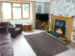 BRIDGE END, end-terrace, open fire, off road parking, decked patio, in Coniston, Ref 25666 - Coniston vacation rentals