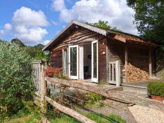 WOODMANCOTE LODGE, pet-friendly romantic lodge with Sky, WiFi, swimming pool, sauna, Linchmere Ref 916403 - Surrey vacation rentals