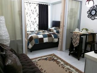 Azure Resort Condo For Rent - Fully Furnished 1BR (Near SM Mall Bicutan) with balcony and internet wifi - Luzon vacation rentals