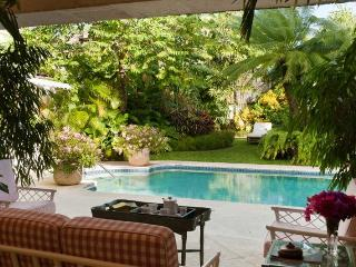 Grand 5 bedroom colonial style home surrounded by lush tropical gardens and great access to the nearby beach - Maynards vacation rentals