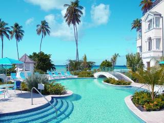 Beachfront 3 bedroom condo overlooking the ocean. Communal pool, outdoor dining and spacious bedroms - Maynards vacation rentals