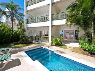 An essential beachfront, 1 bedroom apartment overlooking the ocean with communal pool. - Christ Church vacation rentals