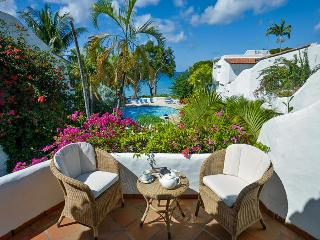 Delightful Mediterranean-style beachfront villa is set within the popular Ian Morrison designed Merlin Bay community and enjoys lovely views - The Garden vacation rentals