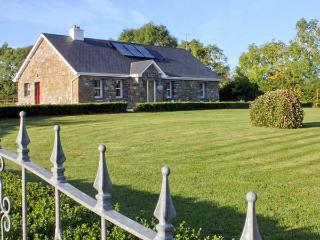 GRANGE LODGE, detached cottage on the banks of Grange Lough, all ground floor, open fire, garden with furniture, near Strokestow - Strokestown vacation rentals