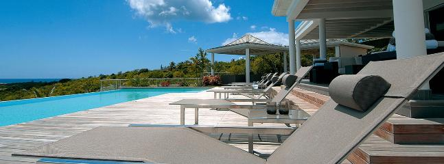 SPECIAL OFFER: St. Martin Villa 146 This Impressive Contemporary Villa Is Nestled Into The Hillside In Terres Basses With Stunning Sunset Ocean Views. - Image 1 - Terres Basses - rentals