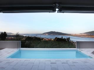 Wonderful view over the river, the sea and Spain. Spectacular sunset!!!! - Northern Portugal vacation rentals