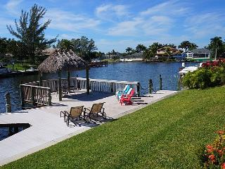 Villa Blue Water - Cape Coral 4b/3ba luxury home w/electric heated pool/spa, gulf access canal, HSW Internet, Boat Dock w/Rental Boat + Tiki Hut - Cape Coral vacation rentals