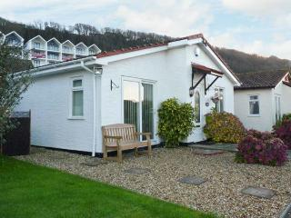 PHOENIX COTTAGE, detached bungalow, conversatory, enclosed courtyard, sea - Holy Island vacation rentals