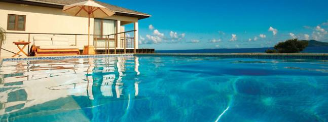 SPECIAL OFFER: Anguilla Villa 48 The Surrounding Waters Are Protected By A Reef, Which Makes For Calm Waters And Excellent Snorkelling. - Image 1 - Little Harbour - rentals