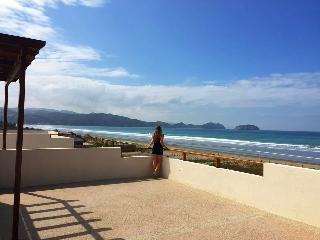 LUXURY BEACHFRONT VILLA IN GATED COMMUNITY - Puerto Cayo vacation rentals