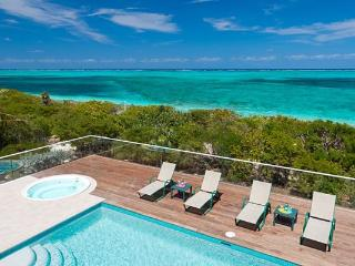 Nestled amid lush, tropical landscaping, this villa fronts miles of white sandy beach. TNC DAW - Providenciales vacation rentals