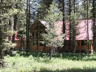 Pine Cone Lodge is settled back in the large fir trees. - Island Park vacation rentals