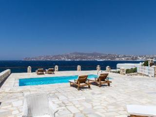 Waterfront Cleo offers dazzling Aegean Sea views, beach access & tranquil pool - Mykonos vacation rentals