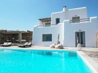 Modern Poseidon One with 3 stone façade villas, superb bay views & infinity pool - Mykonos vacation rentals