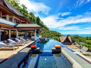 Nestled on a lush hill Yang Som has striking sea views, infinity pool & staff - Surin vacation rentals