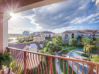 Penthouse 3-bed, 2-bath condo with stunning view of clubhouse and Lake Cay. - Orlando vacation rentals