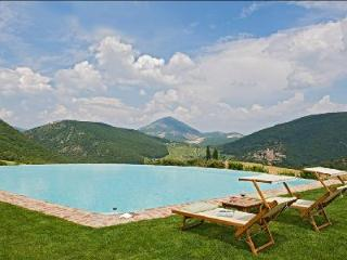 16th century farmhouse Subtilia offers spectacular views, infinity pool & private putting green - Corciano vacation rentals