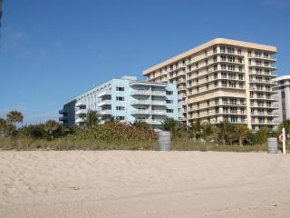 sitting on the beach OCEANFRONT - Surfside vacation rentals