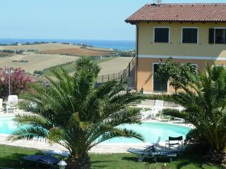 Ground floor Apartment with sea views , large pool - San Costanzo vacation rentals