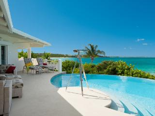 On the westward starting point of Grace Bay, this beachfront villa, with excellent swimming a 5 minute walk from the property, obviously gives way to breathtaking views. TNC TUR - Grace Bay vacation rentals