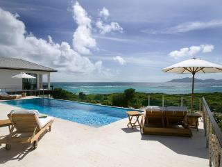 With its own secluded beach cove and views towards St. Martin, this villa is dramatically nestled in the rolling landscape. RIC  - Little Dix vacation rentals