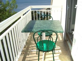Studio apartment with balcony (side sea view) - Cove Zarace (Milna) vacation rentals