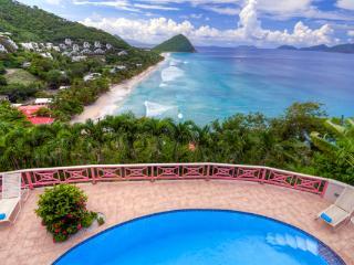 Nestled in lush hills above Long Bay, this villa has spectacular ocean views. KLG SUN - Long Bay vacation rentals