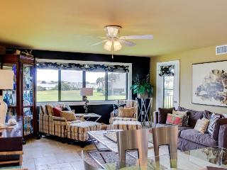 Stylish condo with water views, access to shared pool, tennis, and dock - Pensacola Beach vacation rentals