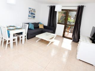 Cozy Condo with Shared Outdoor Pool and Television - Corralejo vacation rentals