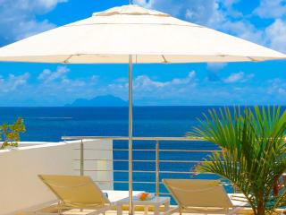 AQUALINA 402 PENTHOUSE... Wow! Fabulous Beachfront condo on Simpson Bay Beach w/ rooftop terrace! - Simpson Bay vacation rentals