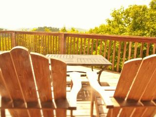 Patchwork Paradise is a gorgeous split-level lakeview vacation cabin constructed with logs and rocks. - New Tazewell vacation rentals