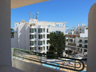 Nearby beach apartment with pool - Olhos de Agua vacation rentals