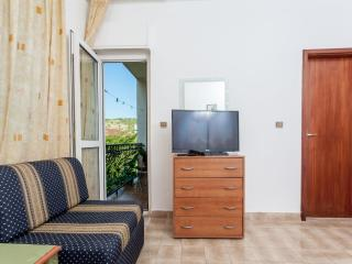 Room with balcony in a house 20m from beach - No.8 - Okrug Gornji vacation rentals