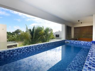 5* apartment w private beach access and pool - Grand Baie vacation rentals