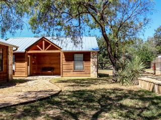 Queen-size bed and flatscreen HDTV in your cozy cabin! - Lakehills vacation rentals