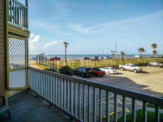 Modern condo across from the seawall with shared pools, hot tubs & a gym! - Galveston Island vacation rentals