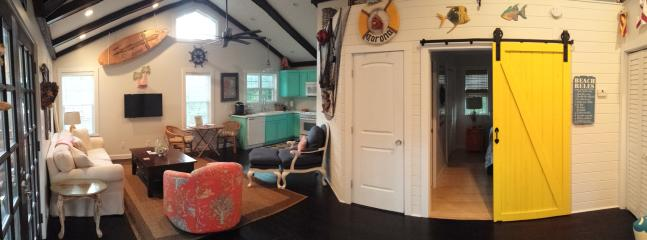 Cosy, open, cathedral ceiling w beachy decor and a yellow barn door to the bedroom. - New Luxury Cottage, Great Location, Duck Pond on Street, Free Bikes & Beach Chairs & Washer / Dryer - Saint Simons Island - rentals