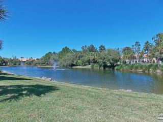 Lake view 2 bedroom top floor condo located in gated resort community - Naples vacation rentals