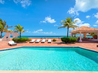 Directly on Baie rouge Beach, surrounded by tropical gardens. All rooms open to tiled terrace and pool. C ROD - Saint Martin-Sint Maarten vacation rentals