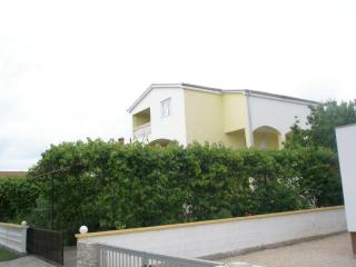 Bright Apartment with Television and Satellite Or Cable TV - Nin vacation rentals