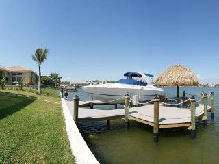 Spacious 5 bedroom vacation home- Pool- Located on lake- Boat access- Fishing opportunities - Cape Coral vacation rentals